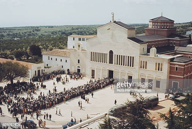 View of mourners and pilgrims queuing to enter the main church in the town of San Giovanni Rotondo in Italy after the death of the priest Padre Pio...