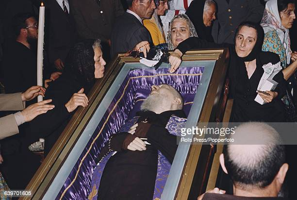View of mourners surrounding the body of Padre Pio in a coffin inside the main church in the town of San Giovanni Rotondo in Italy after the death of...
