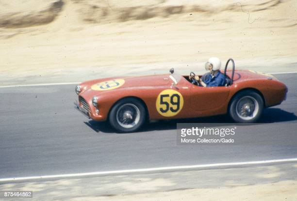 View of Mr Pierre Mion behind the wheel of his 1957 AC AceBristol Roadster No 59 convertible sports car driving at speed during the SCCA National...