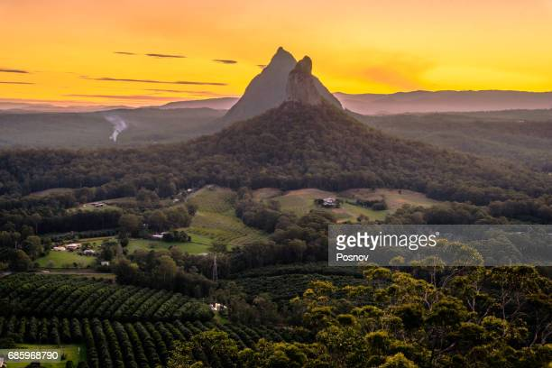 view of mt coonowin and mt beerwah from the top of mt ngungun - glass house mountains stock pictures, royalty-free photos & images