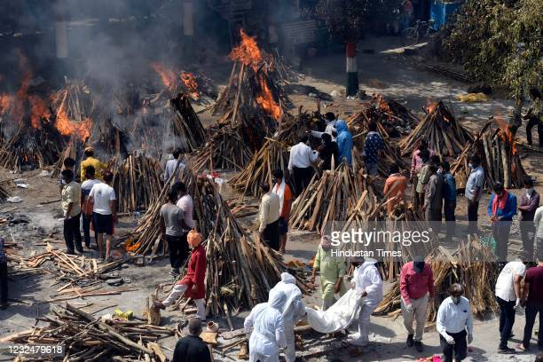 View of multiple funeral pyres of Covid-19 victims, at Gazipur Ghat crematorium, on April 23, 2021 in New Delhi, India.