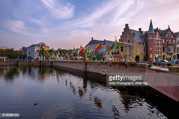 View of Museum De Gevangenpoort and the Flags of the Dutch Departments (Provinces) at the Hofvijve, Hague, Netherlands