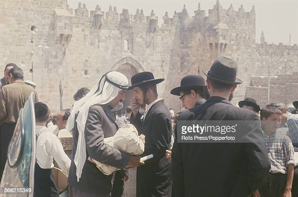 View of muslim arab men and jewish men congregating in front of the Damascus Gate in the city of Jerusalem Israel in July 1967 following the end of...
