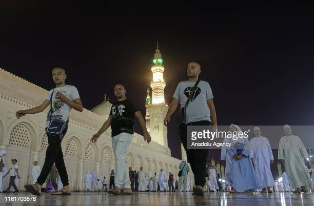 A view of Muslims before the dawn prayer at Masjid alNabawi the mosque that incorporates the final resting place of Prophet Muhammad and the first...