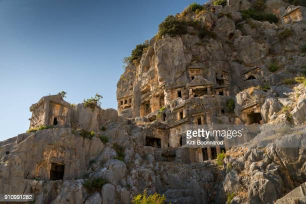 view of myra rock tombs in demre, turkey - antalya province stock pictures, royalty-free photos & images