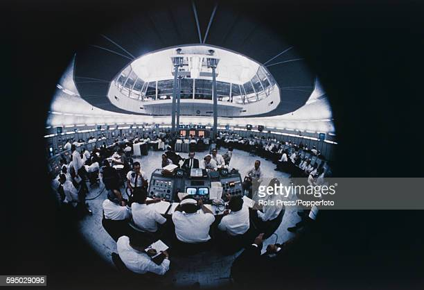 View of NASA technicians preparing for the Apollo 8 launch mission in the Launch Control Centre at the Kennedy Space Center at Cape Canaveral in...