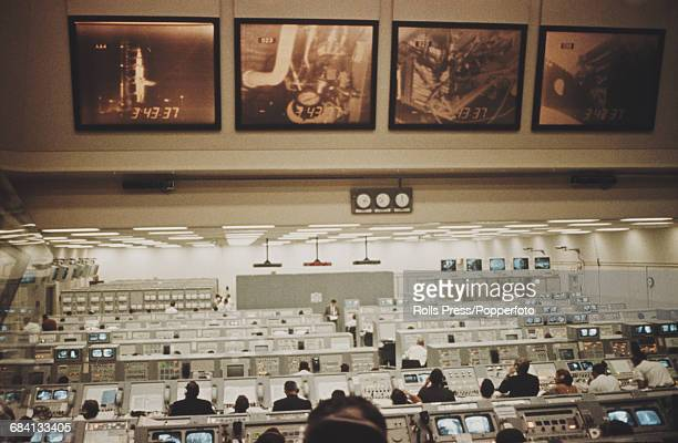 View of NASA technicians preparing for the Apollo 8 rocket launch in the Mission Operation Control Room 2 at the Manned Spacecraft Center in Houston...