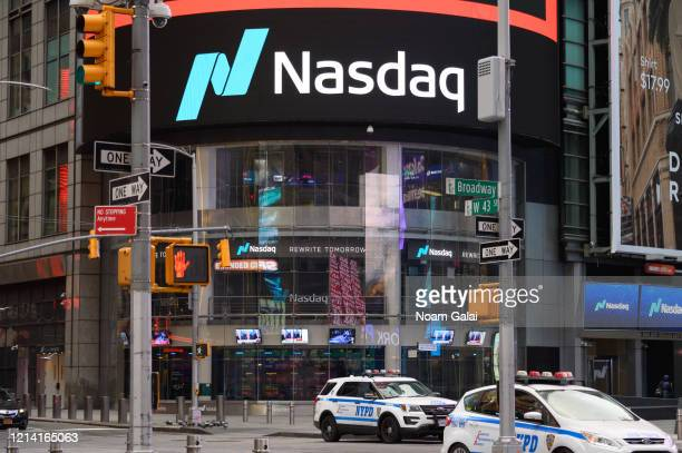 A view of Nasdaq in Times Square hours ahead of the implementation of 'New York State on PAUSE' executive order as the coronavirus continues to...