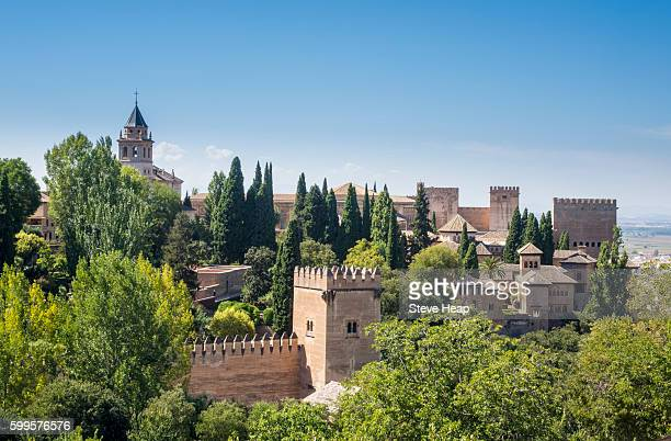 View of Nasrid Palace and church from gardens of Generalife in Alhambra in ancient city of Granada in Andalucia, Spain, Europe