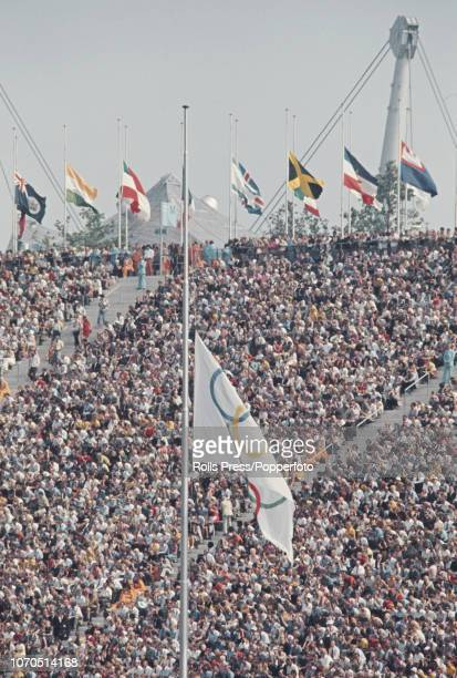 View of national flags and the Olympic flag flying at half mast inside the Olympiastadion during the memorial ceremony for the Israeli athletes and...