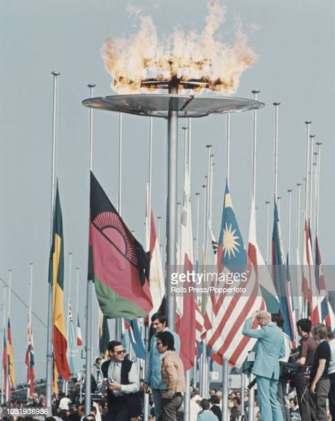 View of national flags flying at half mast behind the Olympic flame during the memorial ceremony for the Israeli athletes and team members killed by...