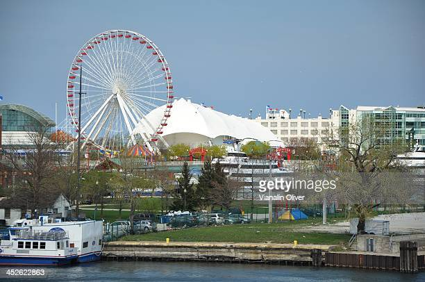 CONTENT] A view of Navy Pier as seen off of Lake Shore Drive which includes the Ferris wheel and one of the cruise ships