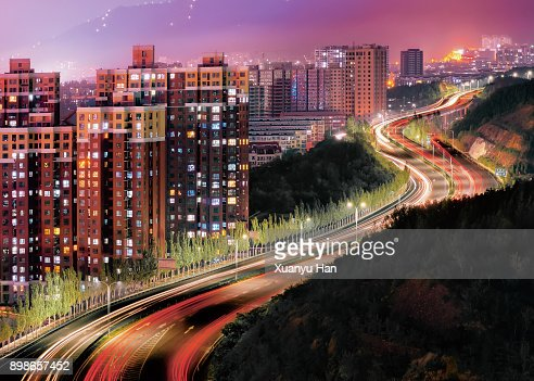 View of neon signs and traffic in Zhangjiakou at night, Hebei, China
