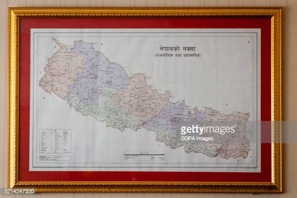 View of Nepal's updated map is seen in a photo frame. Minister for Land Management Padma Aryal released the updated map of Nepal at a program on...