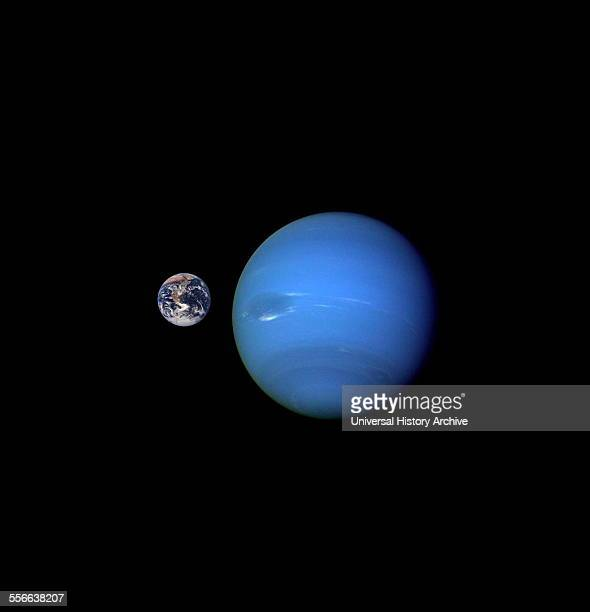 View of Neptune compared to the earth 2003
