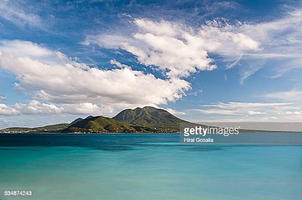 view of nevis from cockleshell beach - st. kitts stock photos and pictures