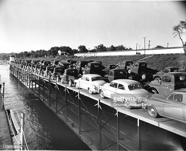 View of new cars and trucks on a river barge near Cincinnati Ohio 1952