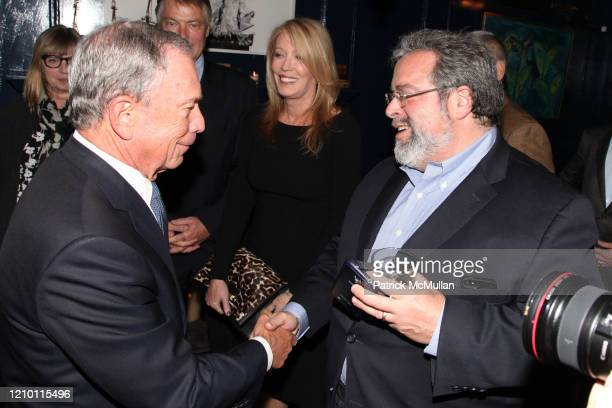 View of New York City Mayor Michael Bloomberg and Drew Nierporent as they talk together during an event at Bill's Food & Drink, New York, New York,...
