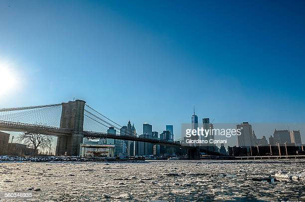view of new york city with east river frozen - cipriani manhattan stock pictures, royalty-free photos & images