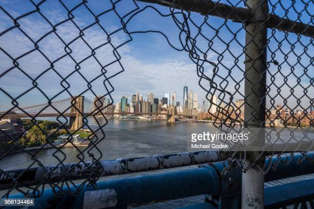 view of new york from manhattan bridge pedestrian walkway - dumbo stock photos and pictures