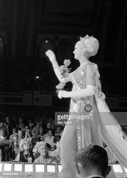 View of newly-crowned Miss America 1969, Judith Ford, as she waves from the runway at Boardwalk Hall during the Miss America beauty pageant, Atlantic...