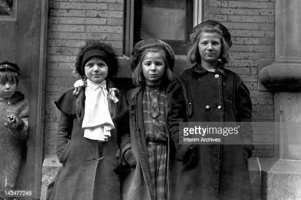 View of newsgirls waiting for papers to sell, Hartford, CT, March 1909. Alice Goldman, on right, has been selling for 4 years, while the other two...