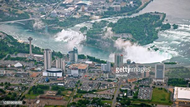 view of niagara falls with city - niagara river stock pictures, royalty-free photos & images