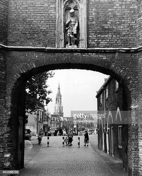 A view of Nieuwe Kerk through the East Gate in Delft Holland Circa 1950