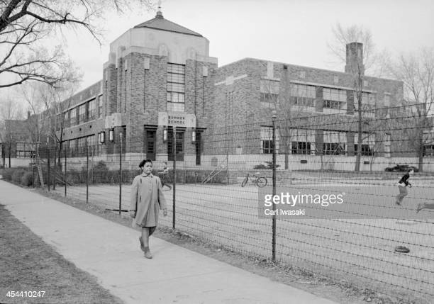 View of nineyearold AfricanAmerican student Linda Brown as she walks past Sumner Elementary School Topkea Kansas 1953 When her enrollment in the...