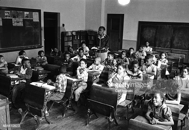 View of nineyearold AfricanAmerican student Linda Brown sits with her classmates at the racially segregated Monroe Elementary School Topeka Kansas...