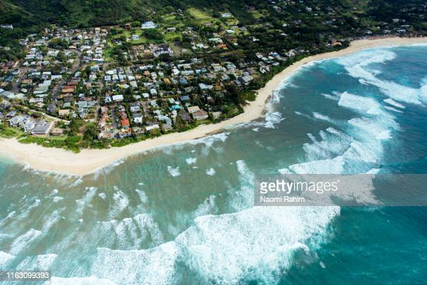 view of north shore neighborhood and surf coastline in oahu, hawaii - media_in_honolulu,_hawaii stock pictures, royalty-free photos & images