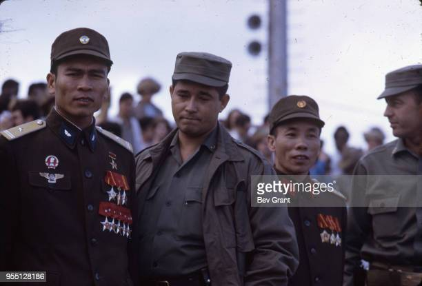 View of North Vietnamese and Cuban solidiers stand together in la Plaza de la Revolucion during the 10th anniversary celebration of the Cuban...