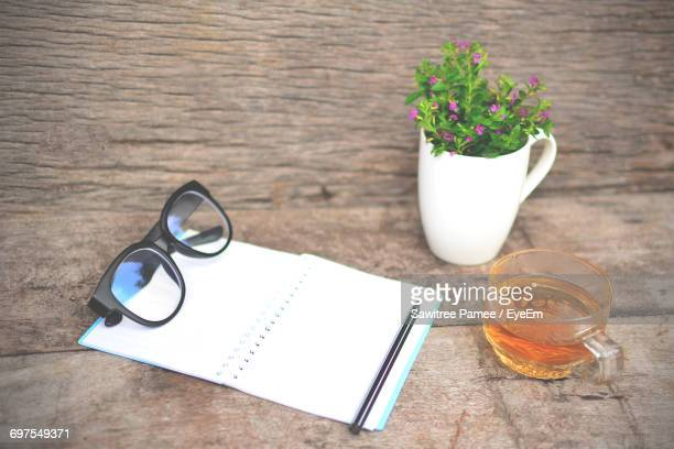 View Of Notebook And Reading Glasses On Table