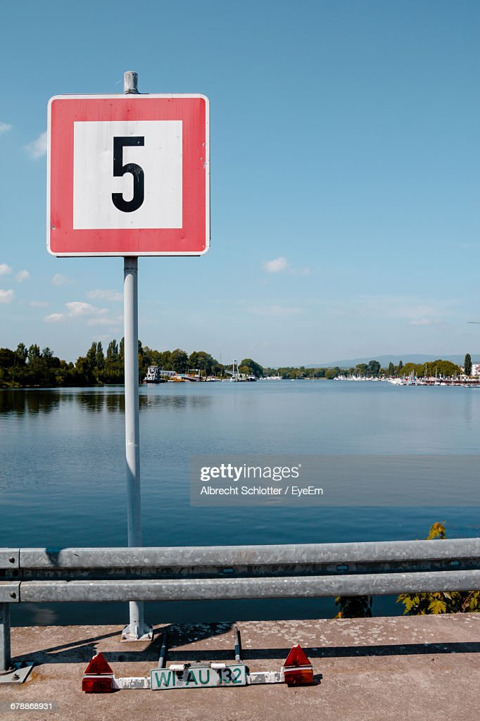 View Of Number On Sign Board Against Cloudy Sky : Stock Photo
