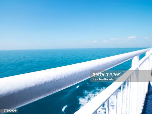 view of ocean beyond white ship railing - passenger craft stock pictures, royalty-free photos & images