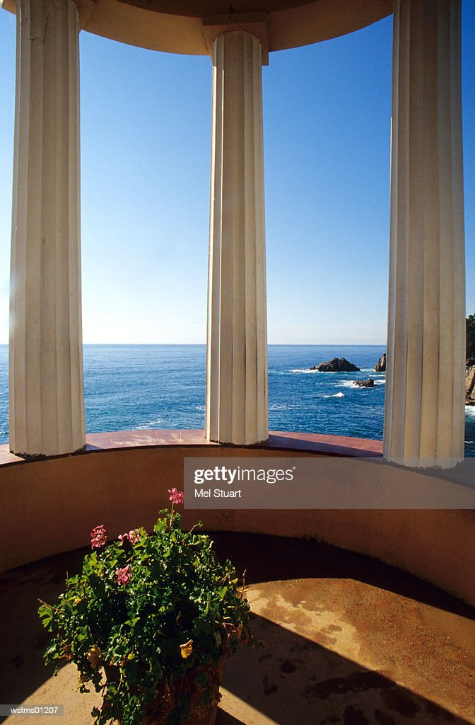 View of Ocean through three columns, Jardi Botanic Mar i Murtra, Blanes, Costa Brava, Catalonia, Spain : Stock Photo