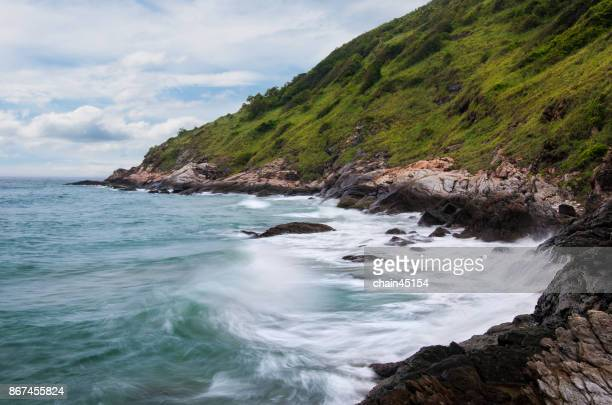 View of ocean waves and fantastic Rocky coast at Phuket in Thailand. Travel destination concept.