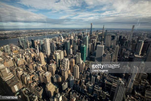 A view of of the west side of Midtown Manhattan from inside the newly renovated 102nd floor observatory of the Empire State Building on October 10...