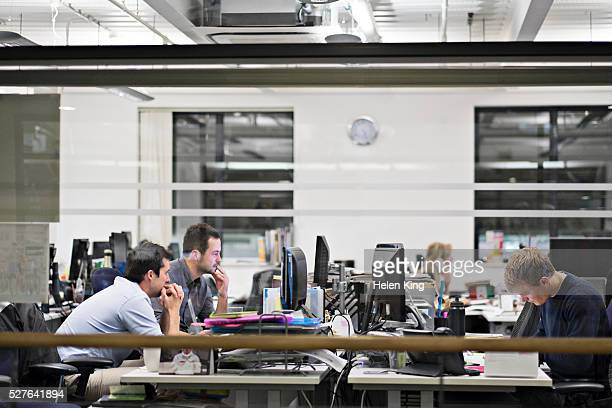 view of office at late hours - open plan stock pictures, royalty-free photos & images