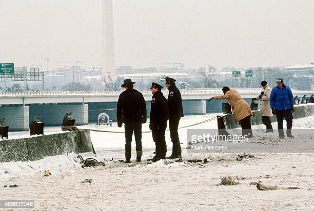 View of officers from the Metropolitan Police Department of the District of Columbia along with unidentified others on the 14th Street Bridge as the...