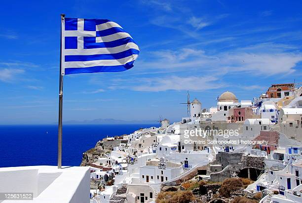 view of oia, santorini - greek flag stock pictures, royalty-free photos & images