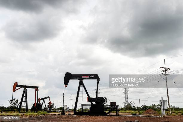 View of oil seesaws on May 2 2018 in Maracaibo Venezuela Amid blackouts skyrocketing prices shortage of food medicine and transportation Venezuelans...
