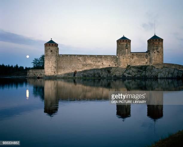 View of Olavinlinna castle at dusk Savonlinna Finland 15th century