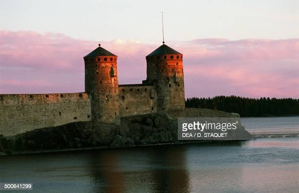View of Olavinlinna castle at sunset founded in 1475 by Erik Axelsson Tott governor of Vyborg and Eastern Provinces dedicated to Olof Norwegian...