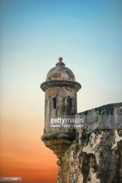 view of old building against clear sky during sunset - puerto rico stock pictures, royalty-free photos & images