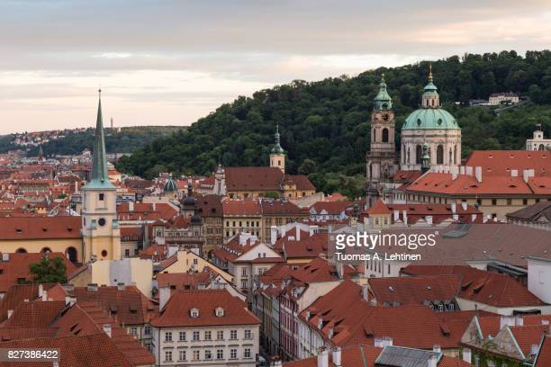 view of old buildings at the mala strana district (lesser town) in prague, czech republic, in the early evening. - st nicholas' church stock pictures, royalty-free photos & images