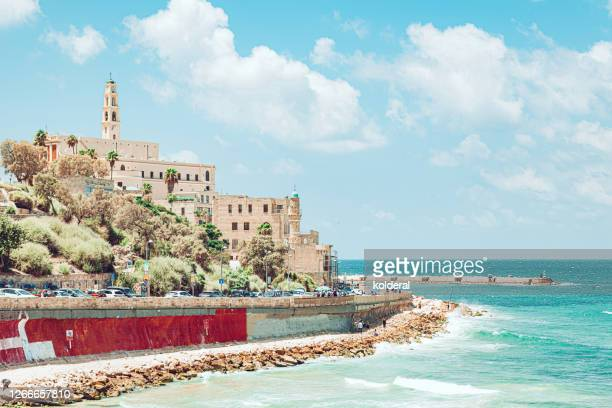 view of old jaffa against mediterranean sea - tel aviv stock pictures, royalty-free photos & images