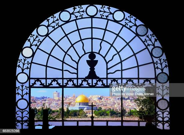 view of old jerusalem and the dome of the rock seen from inside dominus flevit church in the mount of olives or mount olivet in jerusalem, israel - mount of olives stock photos and pictures