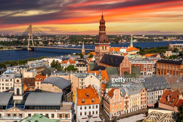 view of old riga at sunset from the st. peter's church, riga, latvia - letonia fotografías e imágenes de stock