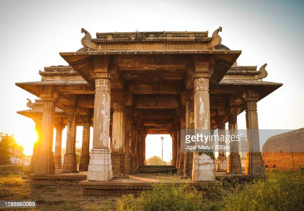 view of old ruins against sky,ahmedabad,gujarat,india - ahmedabad stock pictures, royalty-free photos & images
